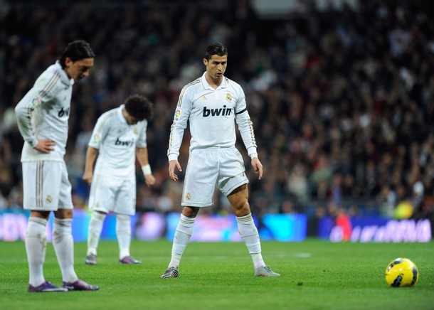 MADRID, SPAIN - JANUARY 22: Cristiano Ronaldo (R) of Real Madrid lines up a free kick beside Mesut Ozil during the La Liga match between Real Madrid and Athletic Bilbao at estadio Santiago Bernabeu on January 22, 2012 in Madrid, Spain. (Photo by Denis Doyle/Getty Images)